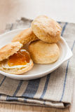 Scones with butter and jam on a napkin and Bank of jam Stock Photo