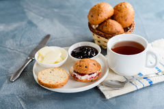 Scones with butter and jam with tea Royalty Free Stock Image
