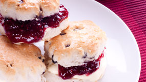 Scones with clotted cream and jam Royalty Free Stock Images
