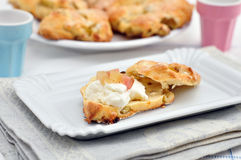 Scones with clotted cream and rhubarb Royalty Free Stock Images