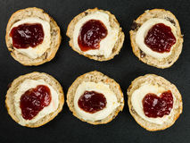 Scones With Clotted Cream and Strawberry Jam. Against a Black Background Royalty Free Stock Image