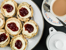 Scones With Clotted Cream and Strawberry Jam Royalty Free Stock Photography