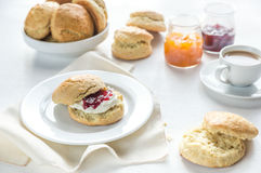Scones with cream and fruit jam and cup of coffee Royalty Free Stock Image