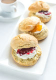 Scones with cream and fruit jam Royalty Free Stock Photo