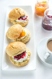 Scones with cream and fruit jam Royalty Free Stock Photos