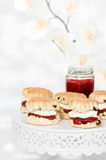 Scones With Cream & Jam. Comport of scones with cream and strawberry jam Royalty Free Stock Images