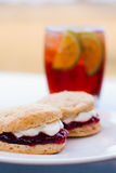 Scones with cream and jam and ice tea Royalty Free Stock Photo