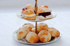 Scones. English scones with clotted cream and jam Royalty Free Stock Images