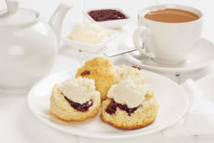 Scones with Jam and Cream. And a cup of tea Stock Photos