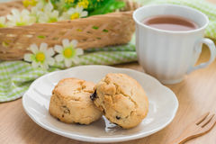 Scones on plate and cup of tea Stock Photos