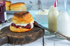 Scones with strawberry jam and clotted cream. Traditional English scones with strawberry jam and clotted cream Royalty Free Stock Photo