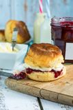 Scones with strawberry jam and clotted cream. Traditional English scones with strawberry jam and clotted cream Royalty Free Stock Photos
