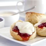 Scones with Strawberry Jam and Cream Devonshire Tea. Scones with strawberry jam and cream. Traditional English or Devonshire tea Stock Photos