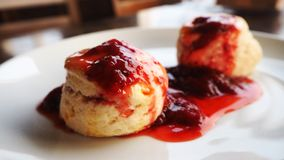 Scones with strawberry jam. Traditional English afternoon tea scones local dessert royalty free stock images