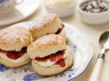 Scones Tea Clotted Cream and Jam. With a spoon Stock Photo