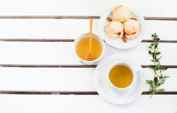 Scones and tea. On wooden white table Royalty Free Stock Photography