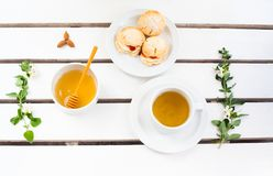 Scones and tea. On wooden white table Royalty Free Stock Photo