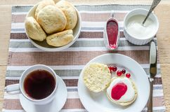 Scones with whipped cream and cranberry jam Royalty Free Stock Photos