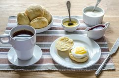 Scones with whipped cream, lemon curd and cranberry jam Royalty Free Stock Photos