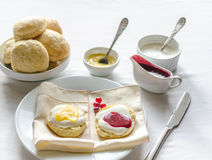 Scones with whipped cream, lemon curd and cranberry jam Royalty Free Stock Photography