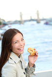 Scones - woman eating scone in London Royalty Free Stock Image