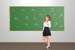 Scoolgirl in the classroom Stock Images