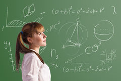 Scoolgirl in the classroom Royalty Free Stock Photography