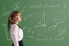 Scoolgirl in the classroom Royalty Free Stock Images