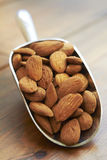 Scoop Of Almonds On Wooden Surface Royalty Free Stock Photo