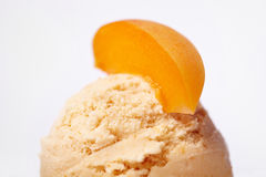 Scoop of apricot ice cream Stock Photography
