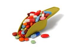Scoop avec des pilules photographie stock libre de droits