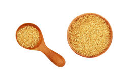 Scoop and bowl of brown cane sugar on white Royalty Free Stock Image