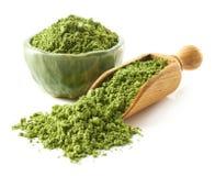 Scoop and bowl of green matcha tea powder Royalty Free Stock Image