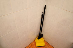 Scoop with a broom in the corner Royalty Free Stock Photography
