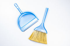 Scoop and broom isolated on white Stock Photo