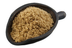 Scoop of brown cane sugar Stock Photo