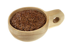 Scoop of brown flax seeds Stock Images