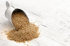 Scoop of Brown Rice on Rustic White Timber Stock Images