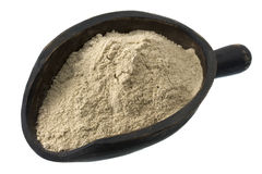 Scoop of buckwheat flour royalty free stock photography