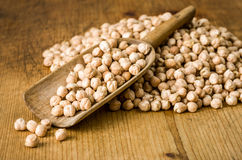 Scoop with chickpeas. A wooden scoop with chickpeas Stock Photos