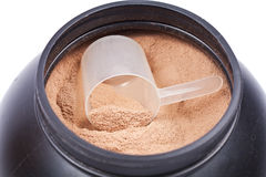 Scoop of chocolate whey isolate protein. In a black plastic container on white Stock Image