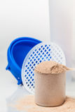 Scoop of chocolate whey isolate protein Royalty Free Stock Photos