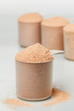 Scoop of chocolate whey isolate protein Stock Photos