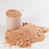 Scoop of chocolate whey isolate protein powder Royalty Free Stock Images