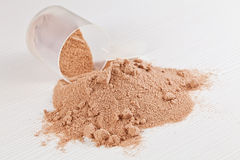 Scoop of chocolate whey isolate protein powder stock photo