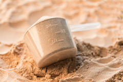 A scoop of chocolate whey isolate protein Royalty Free Stock Photography