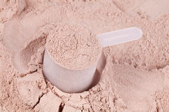 Scoop of chocolate whey protein Royalty Free Stock Photos