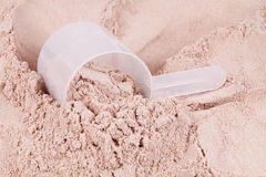 Scoop of chocolate whey protein Stock Images