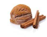 A scoop of cinnamon ice cream with cinnamon sticks stock images