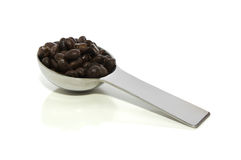 Scoop of coffee on white with clipping path Royalty Free Stock Photos
